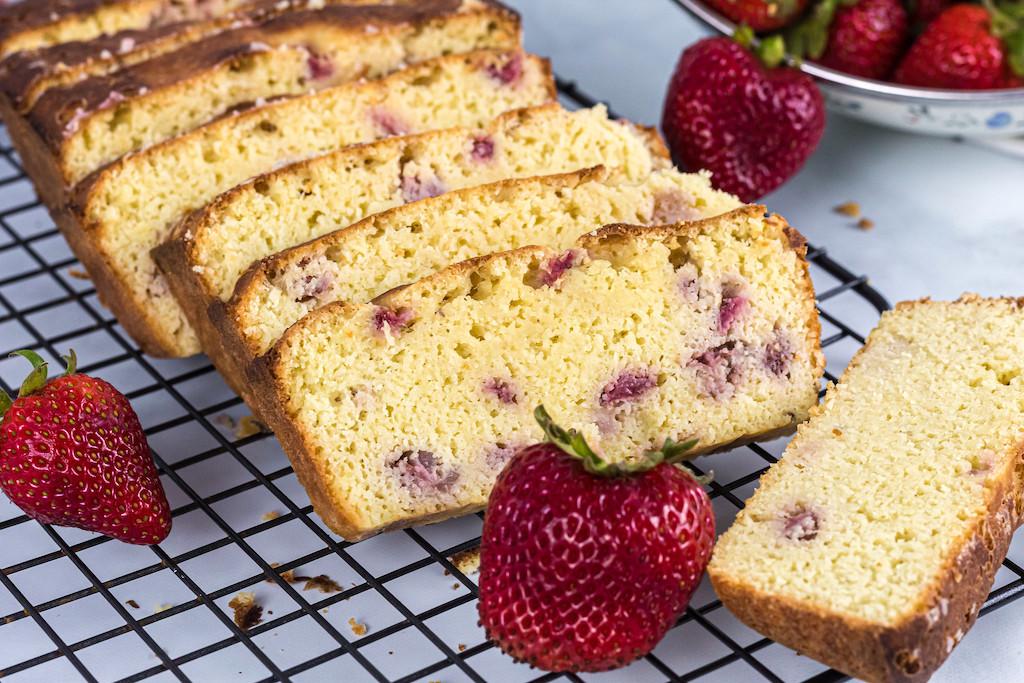 sliced keto strawberry shortcake bread with fresh strawberries