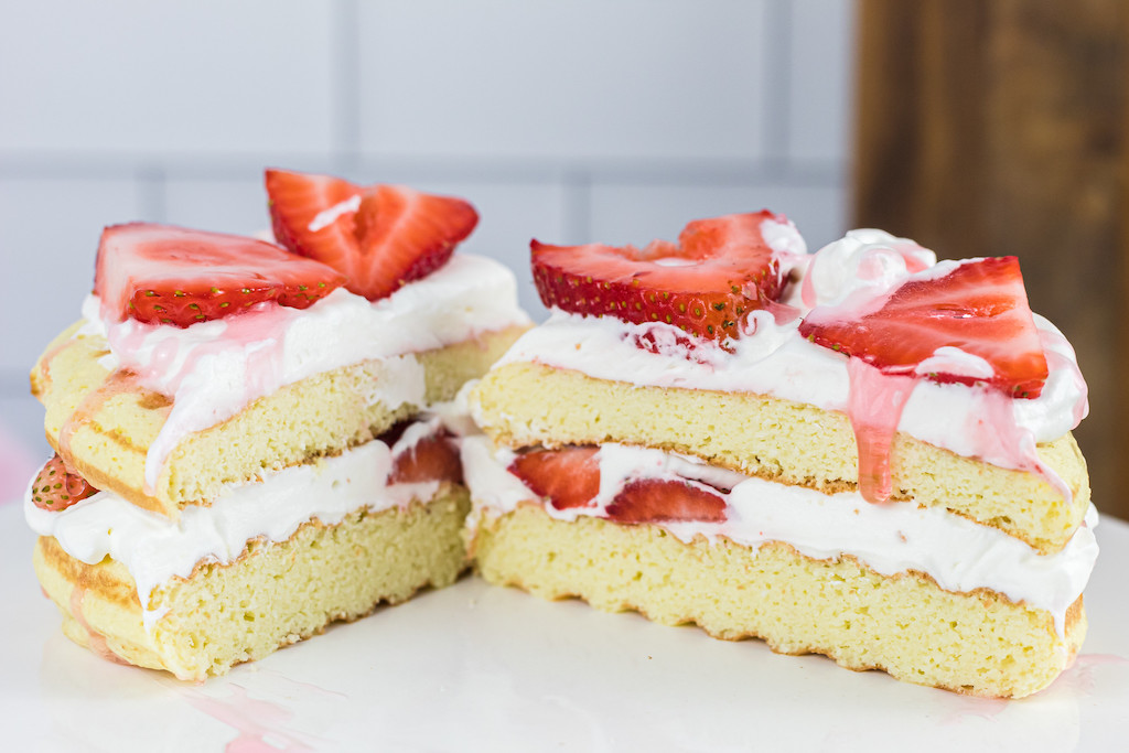 keto strawberry shortcake chaffle sliced in half