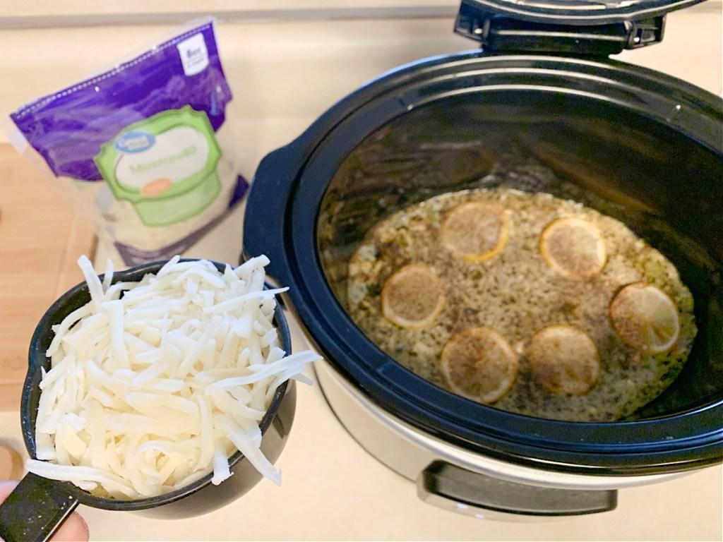 adding mozzarella to lemon pesto chicken