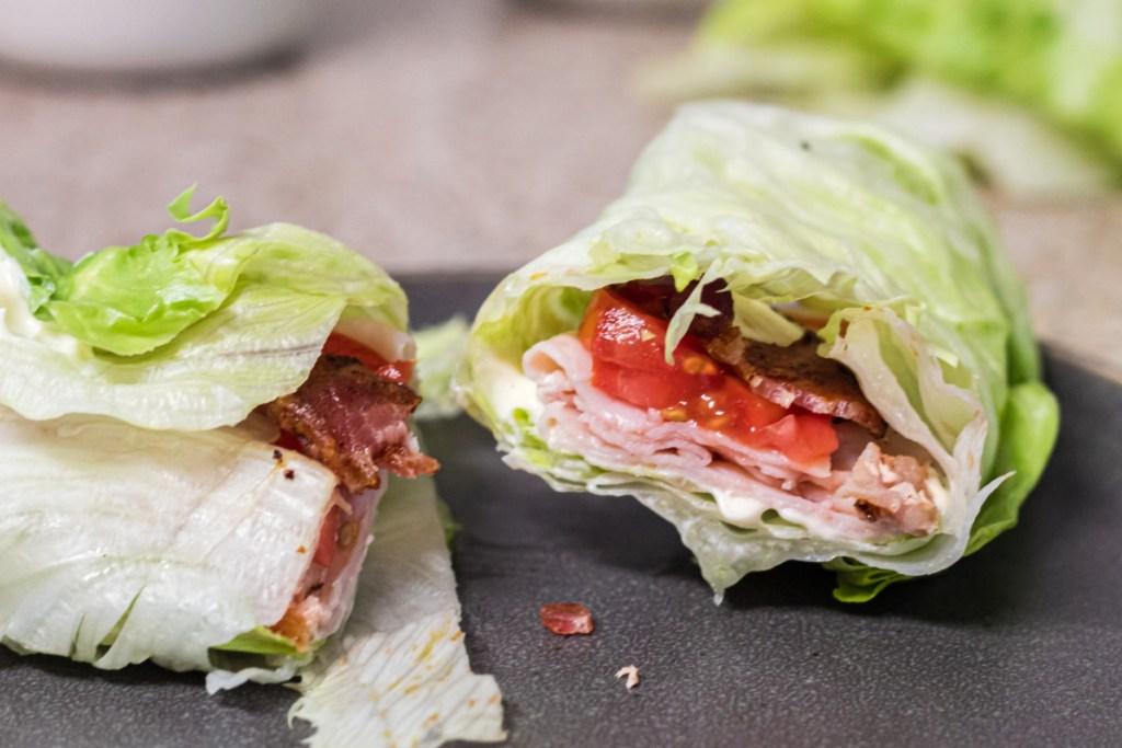 a looking inside a lettuce wrap