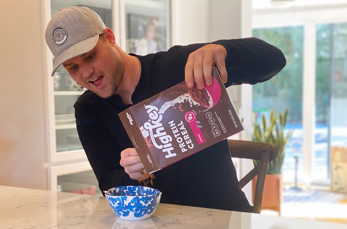 man eating high key protein cereal