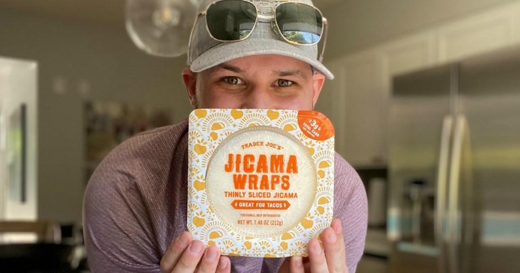 man holding Trader Joe's jicama wraps