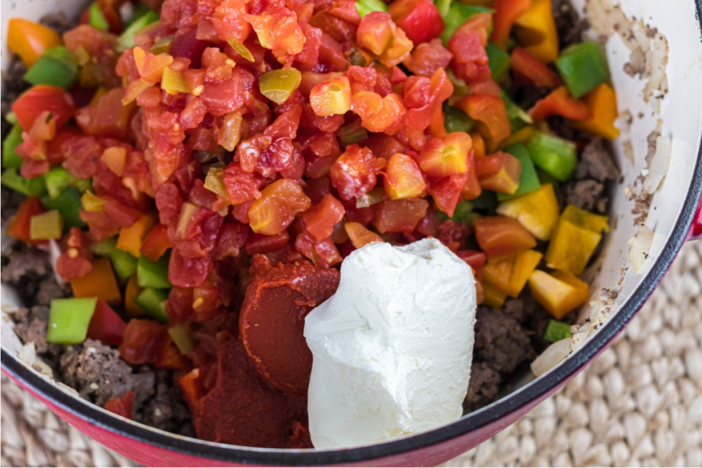 tomatoes, peppers, and sour cream in dutch oven