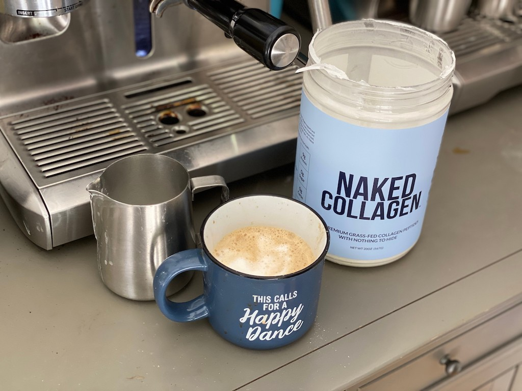 Naked Collagen and latte on counter by espresso machine