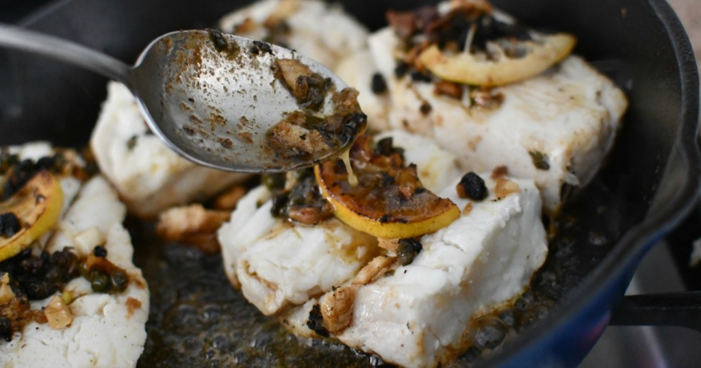 pouring butter on the halibut