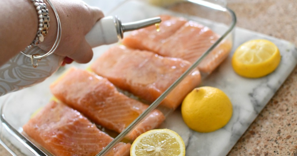drizzling olive oil over salmon