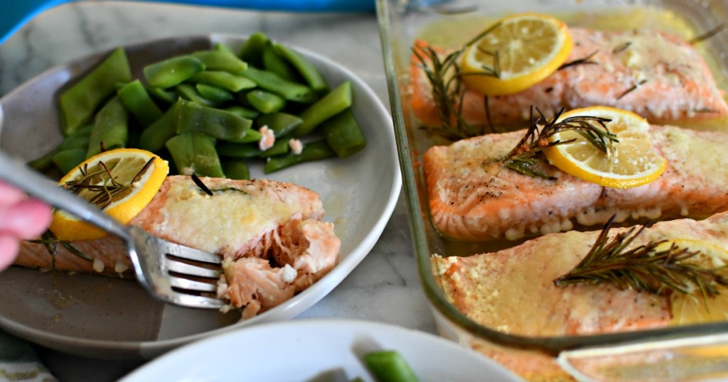 plated salmon with snap peas and additional salmon filets