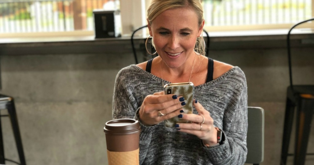 woman text messaging in coffee shop