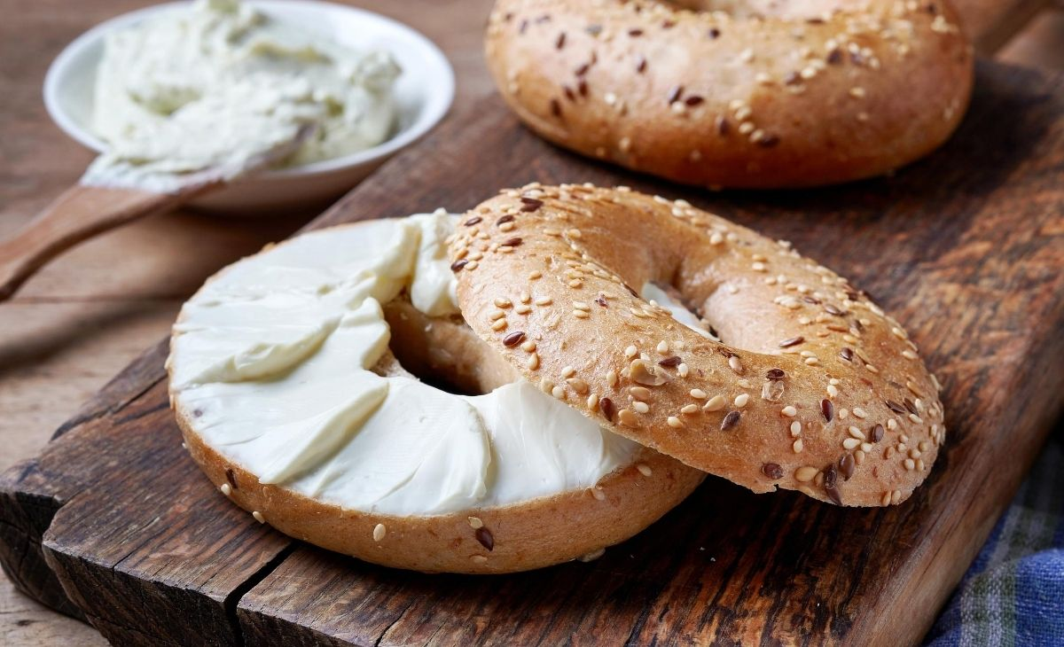 Bagels with cream cheese on a table