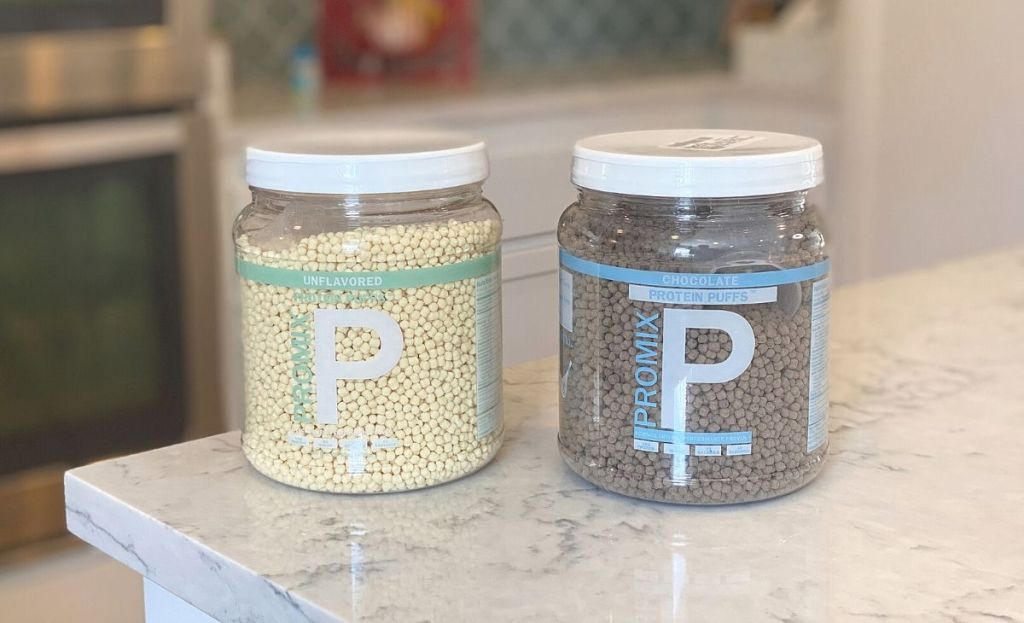 2 containers of Promix protein puffs on a counter