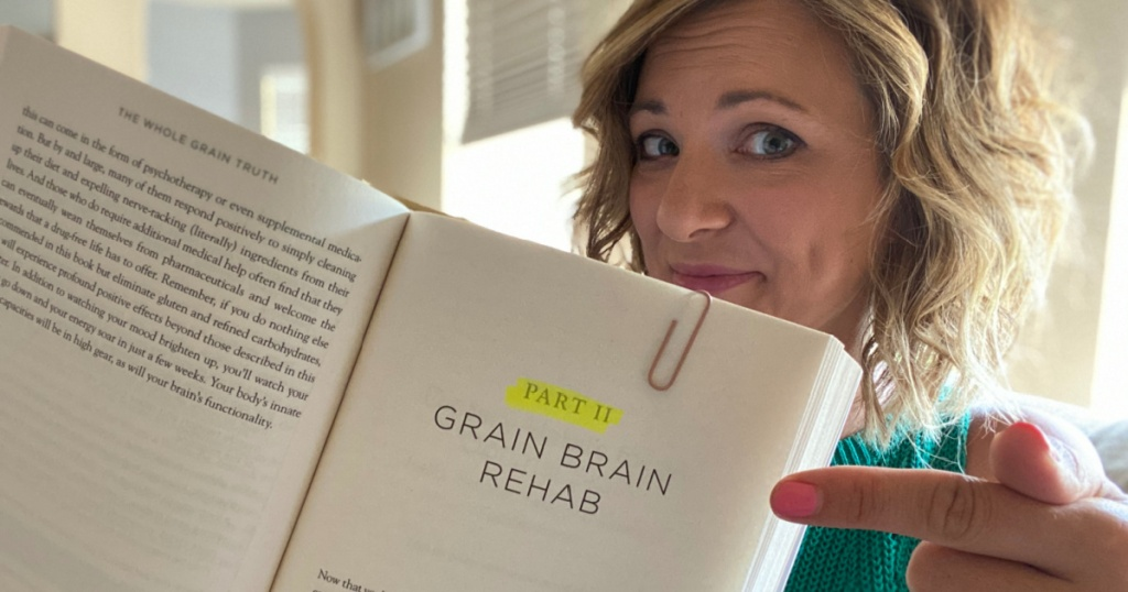 Girl holding Grain Brain book