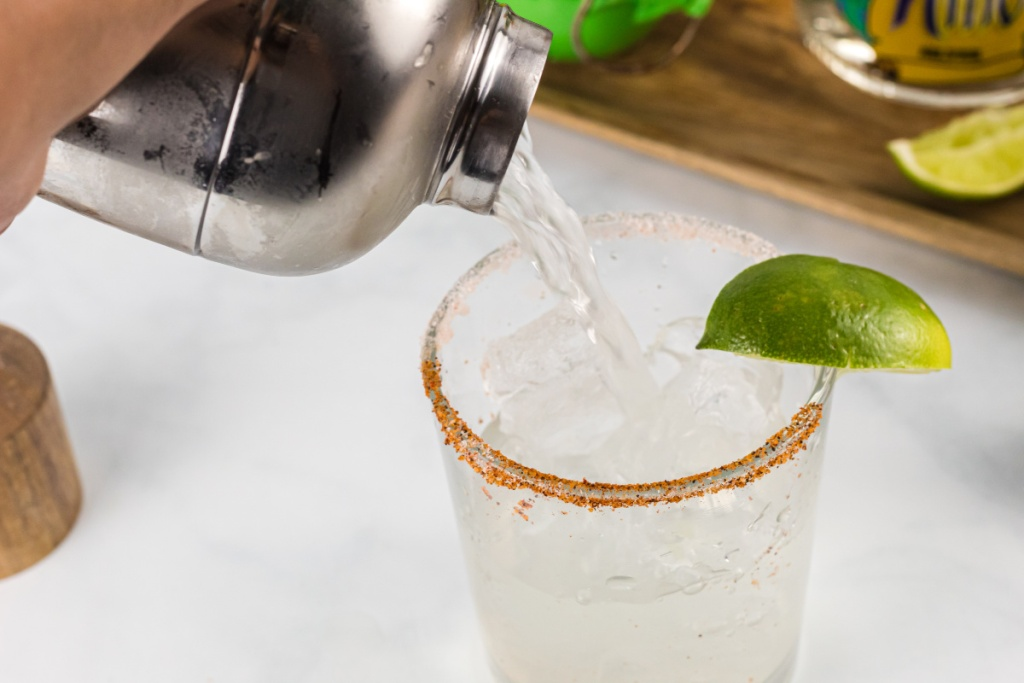 pouring margarita in glass