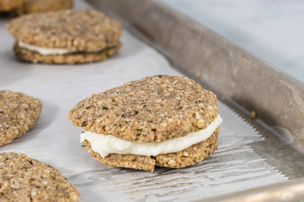oatmeal cream pies with frosting on cookie sheet