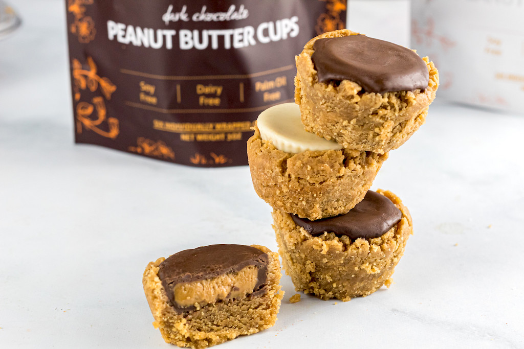 keto peanut buttter cup cookies stacked on top of each other