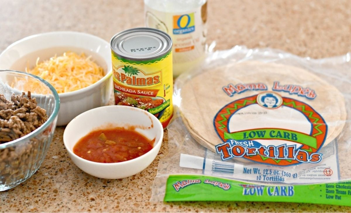 Tortillas and taco ingredients on a counter