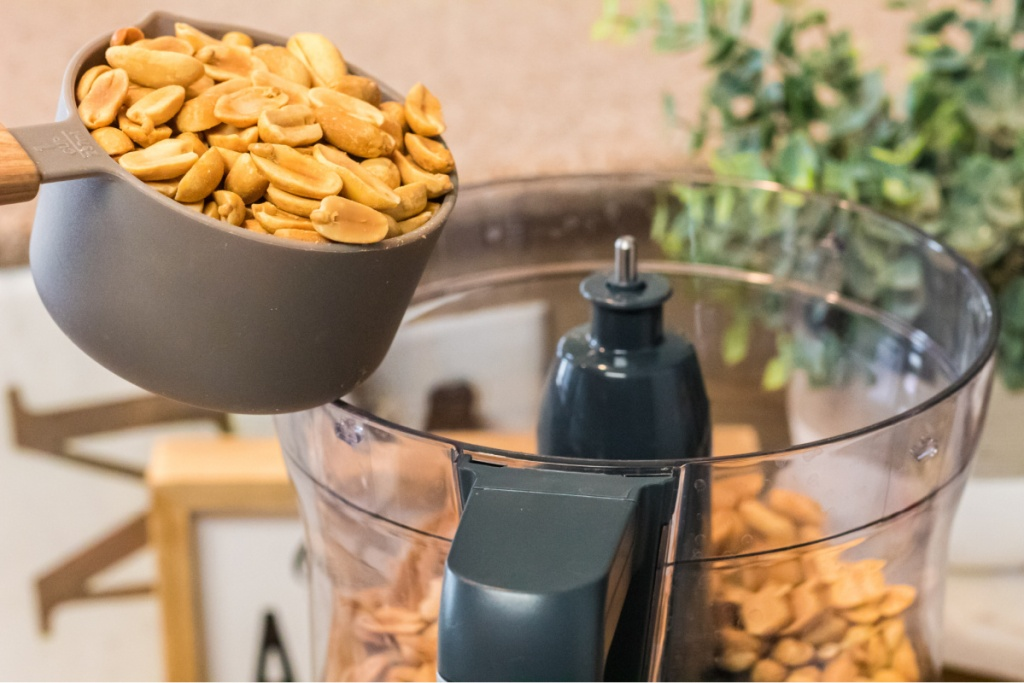 pouring peanuts into food processor