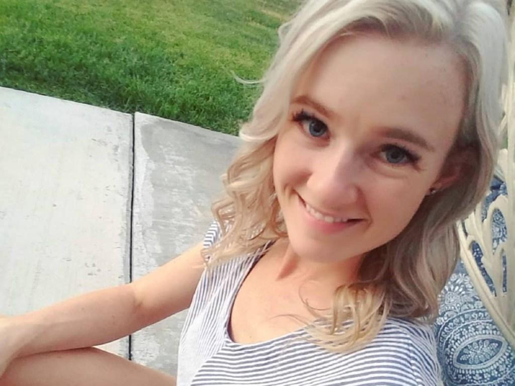 woman wearing striped shirt outside