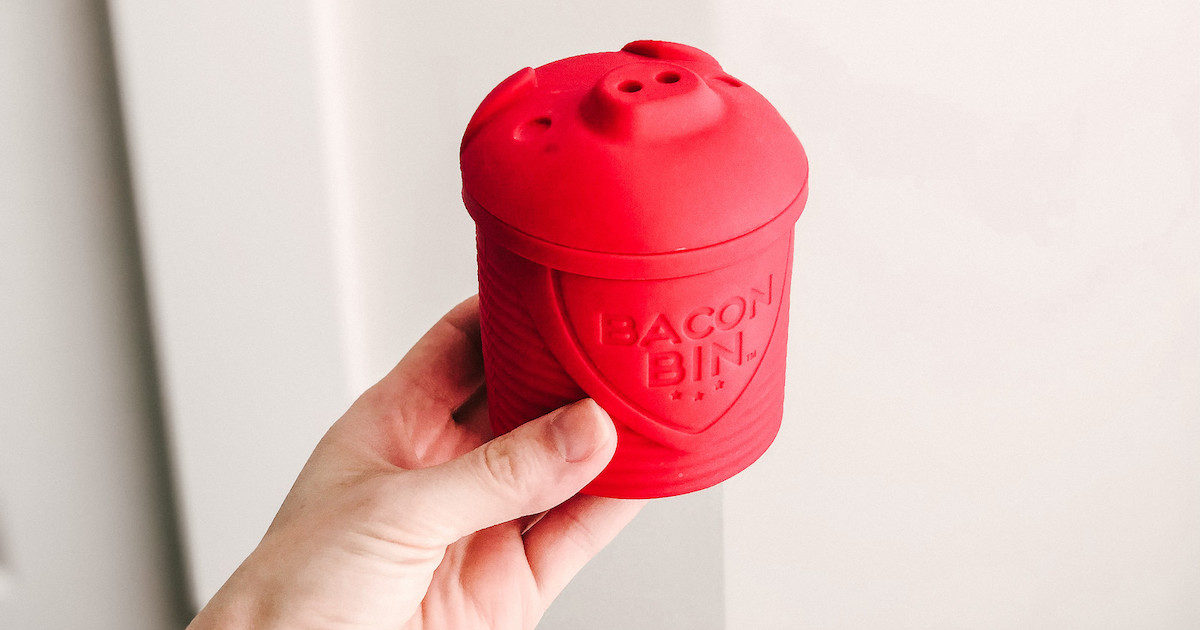 hand holding a red bacon bin