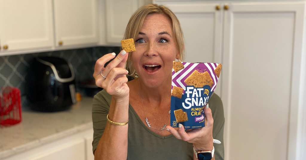 woman holding up keto-friendly Fat Snax cracker