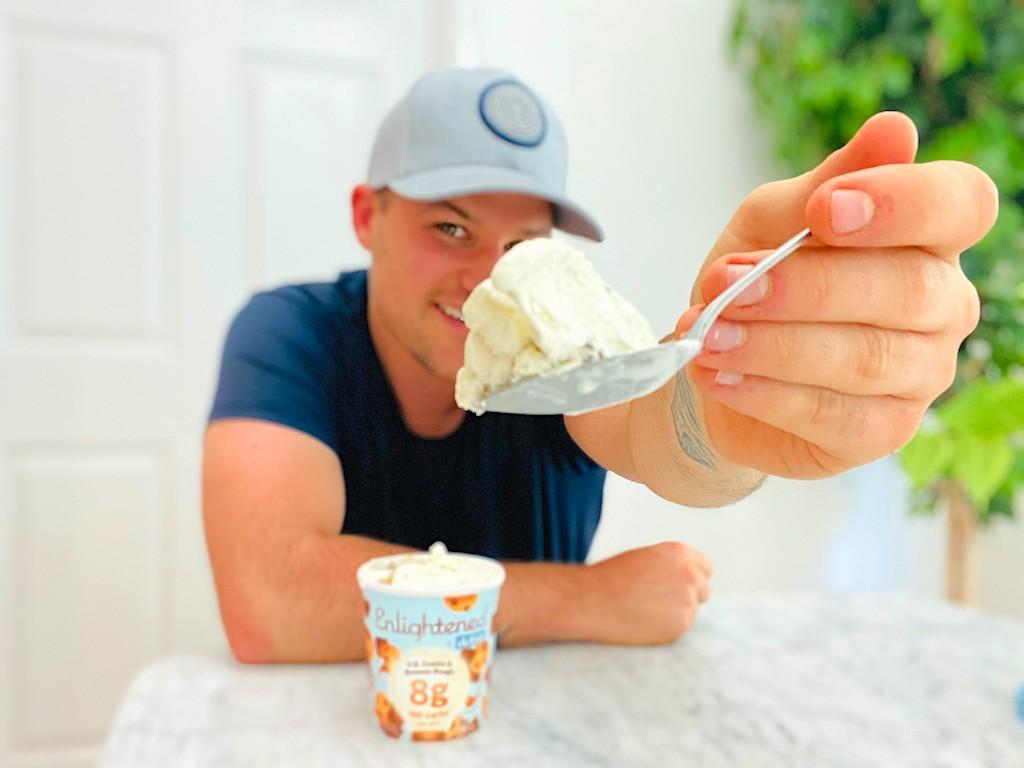 man holding Enlightened ice cream on spoon
