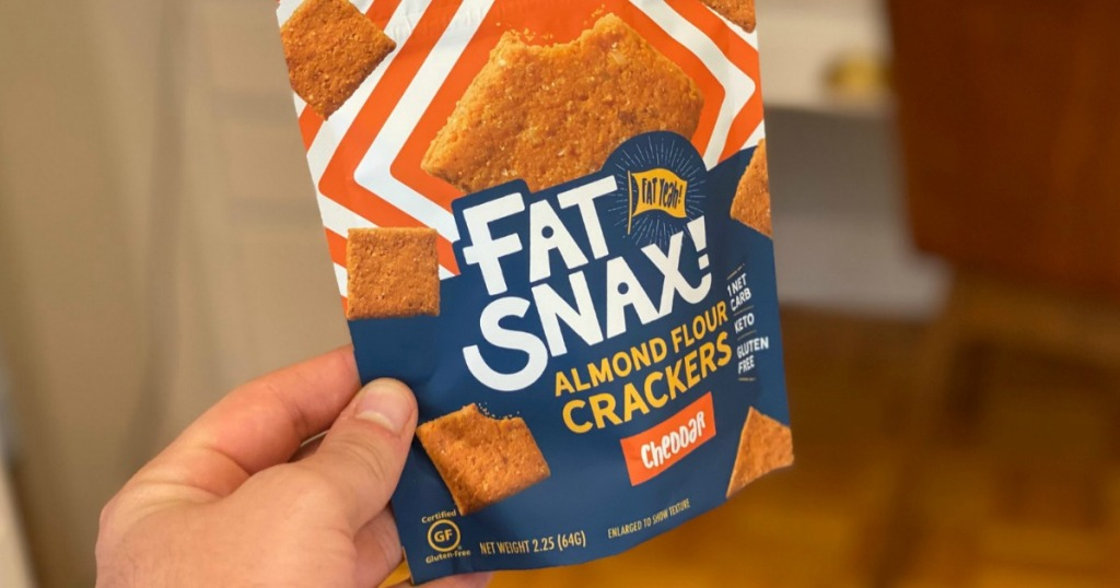 holding bag of Fat Snax crackers