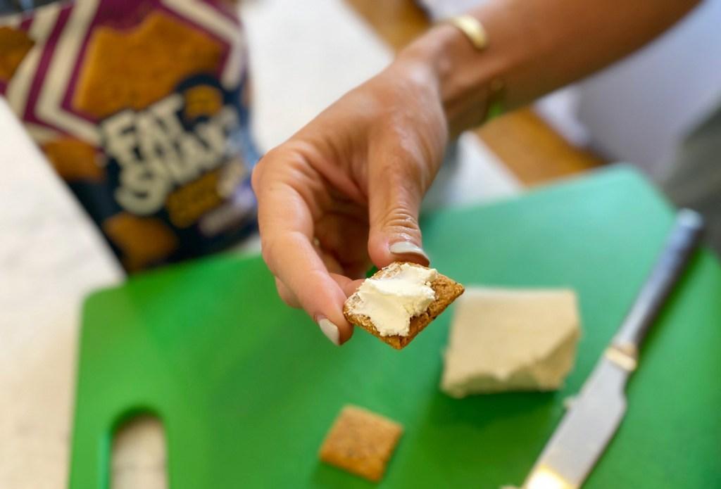 hand holding cracker