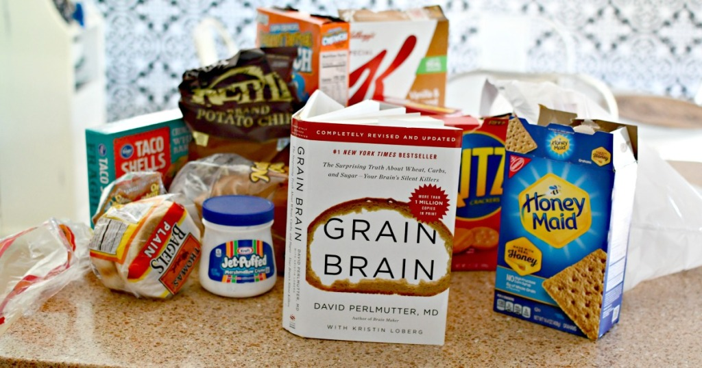 grain brain book surrounded by highly processed foods