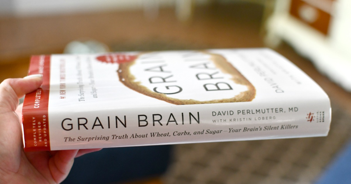 holding a copy of Grain Brain
