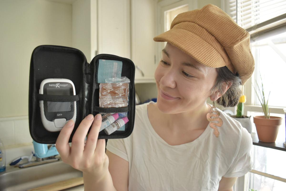 woman holding Keto Mojo case