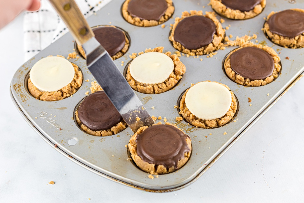lifting out peanut butter cup cookie from pan