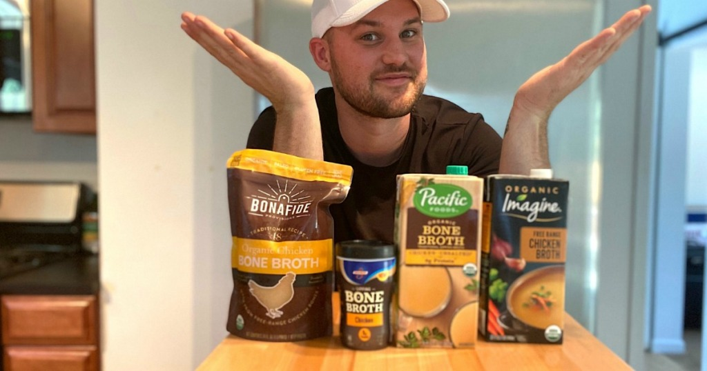 man behind chicken broth and bone broths on counter
