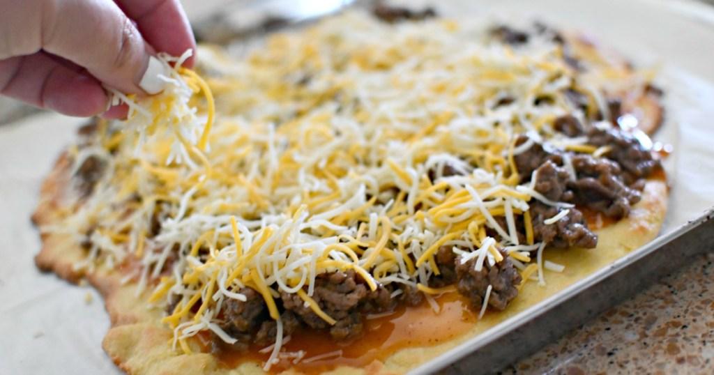 melting cheese on keto taco pizza