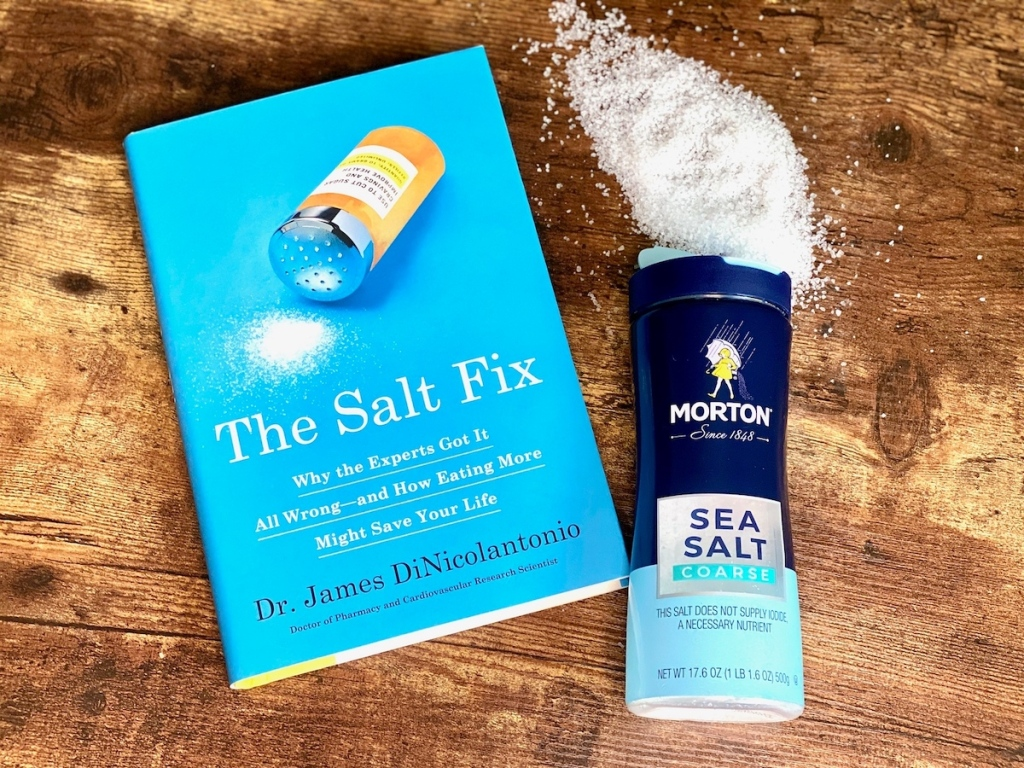 the salt fix book on table with bottle of sea salt