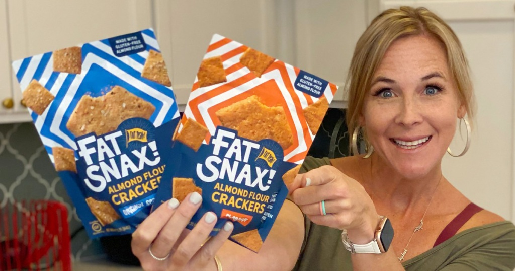 woman holding fat snax crackers