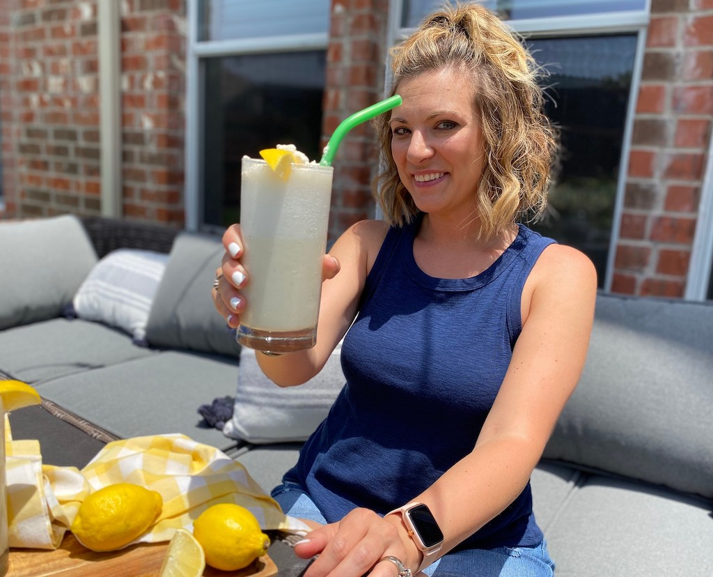 woman holding keto frosted lemonade