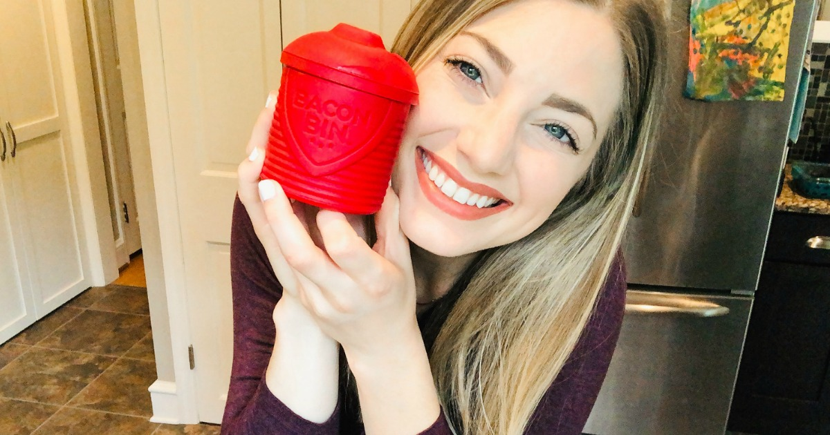 woman smiling while holding red bacon bin
