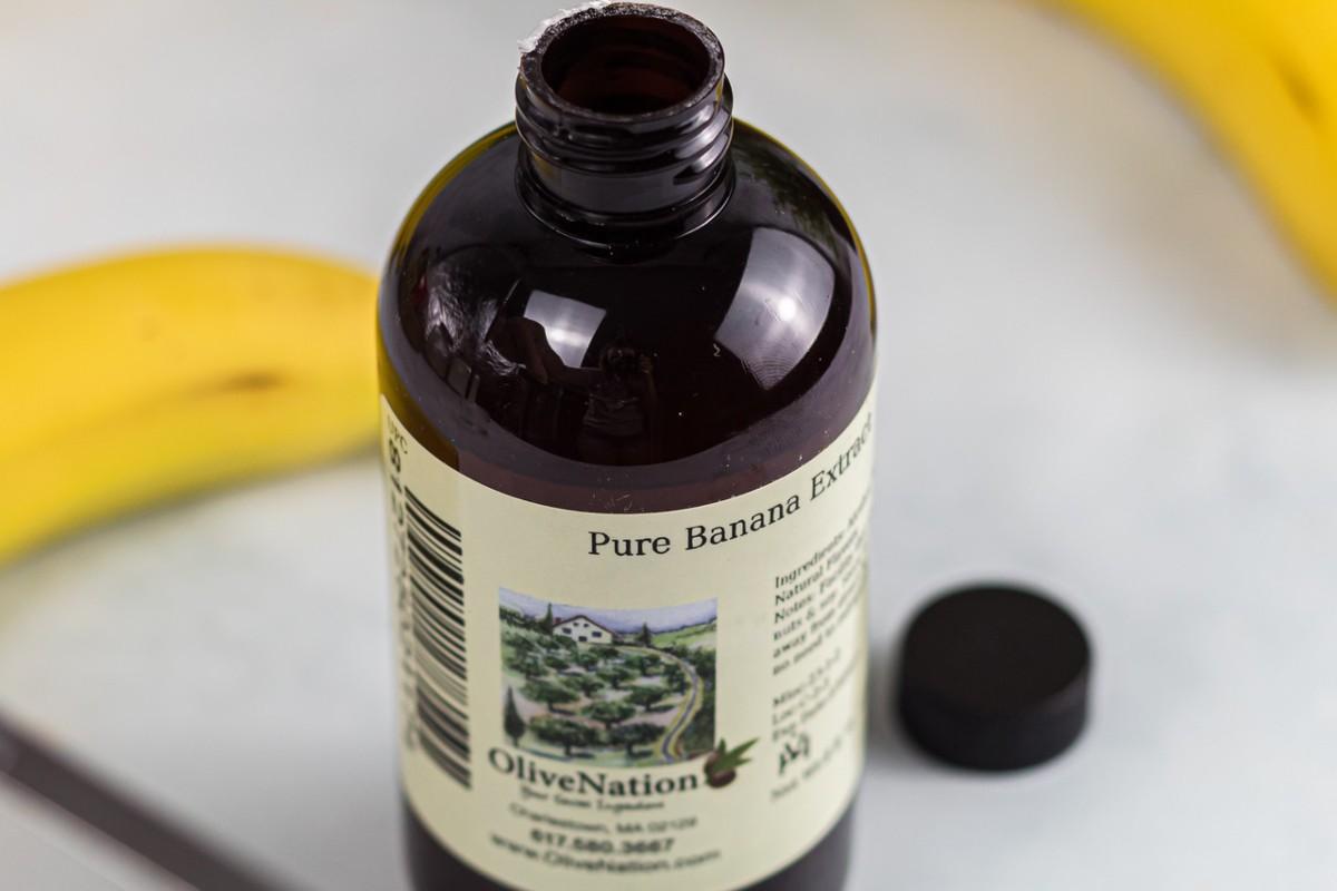 open bottle of banana extract and bananas
