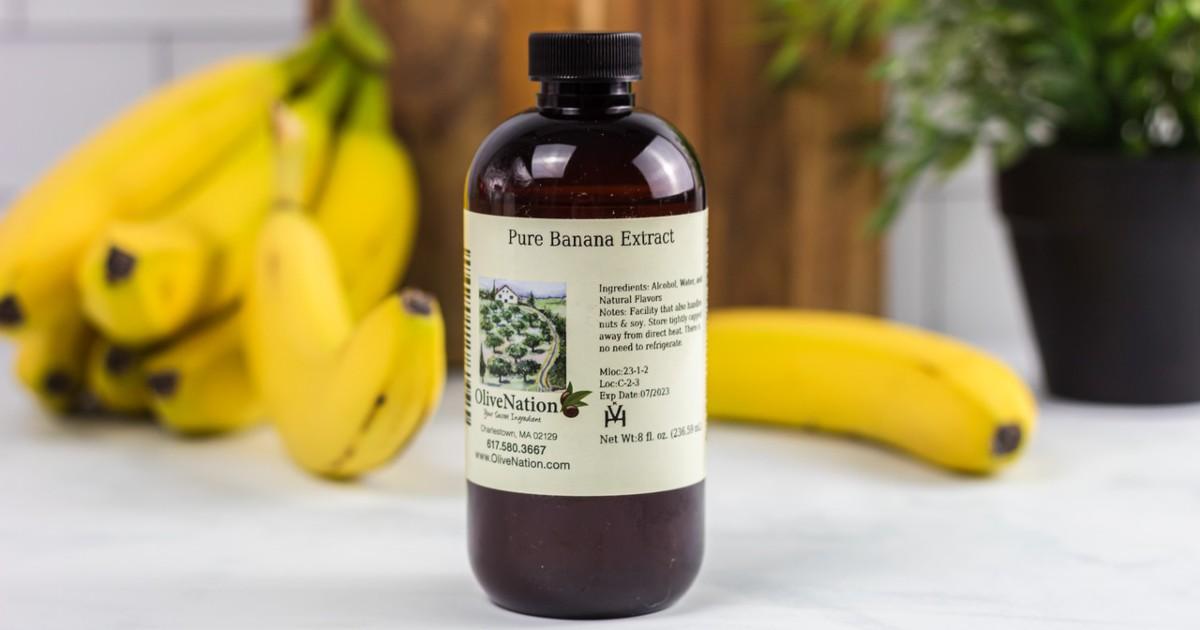 bottle of banana extract next to bananas