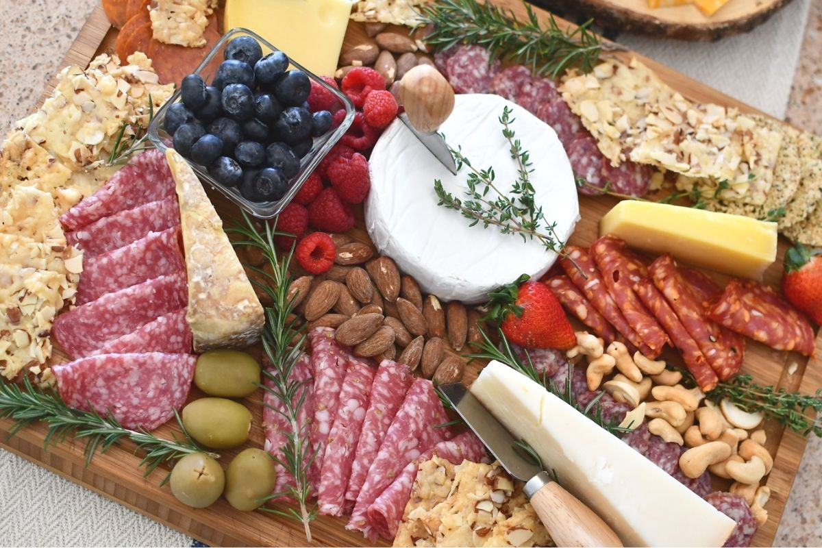A charcuterie board with food on it