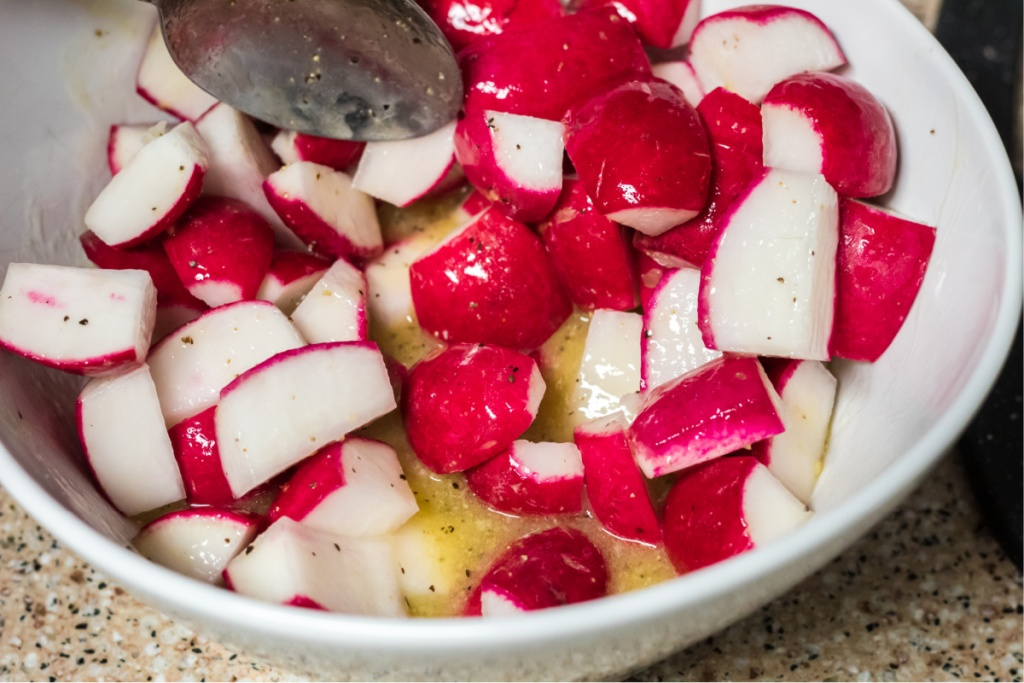 mixing radishes in with melted butter