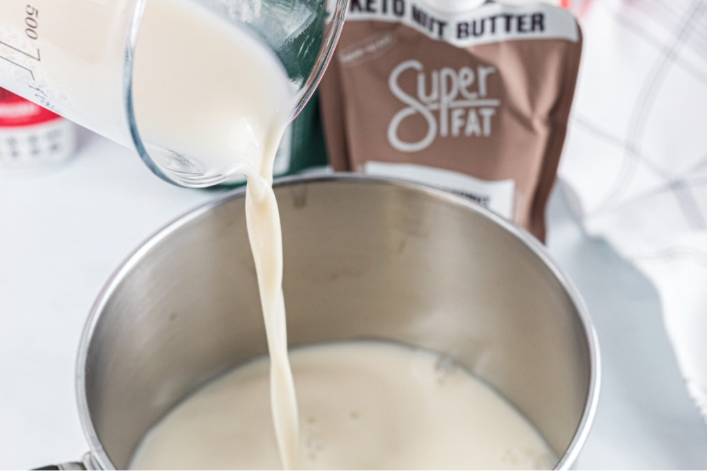 almond milk being poured into saucepan