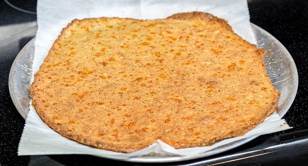 pork rind pizza crust on pan