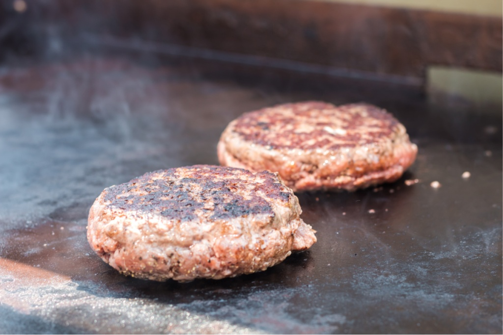 stuffed burgers on a griddle