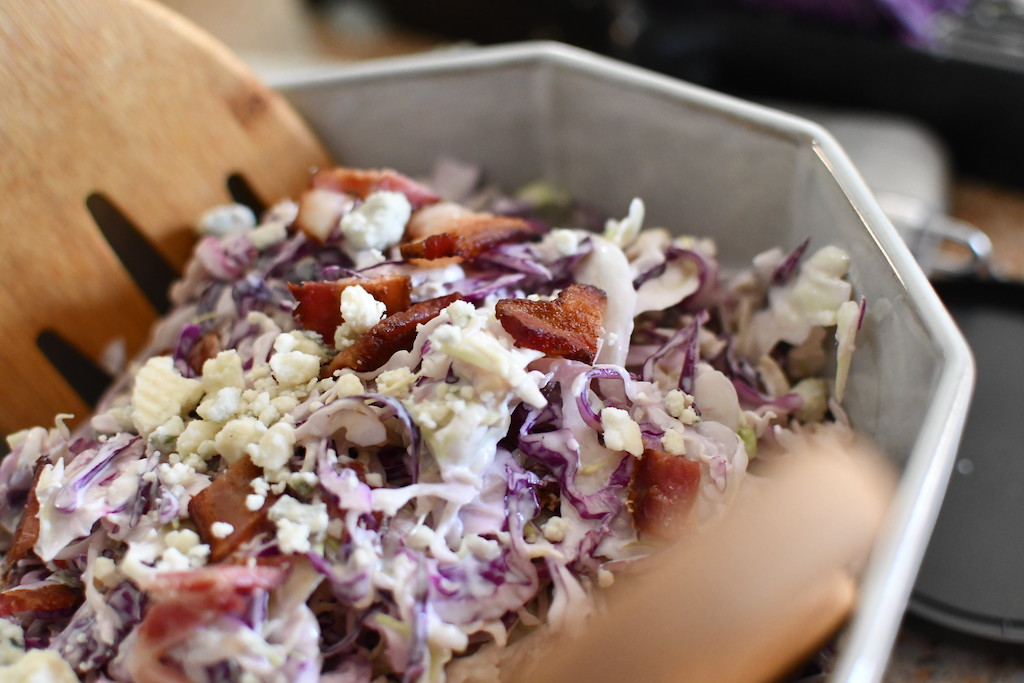 close up of keto coleslaw with blue cheese and bacon