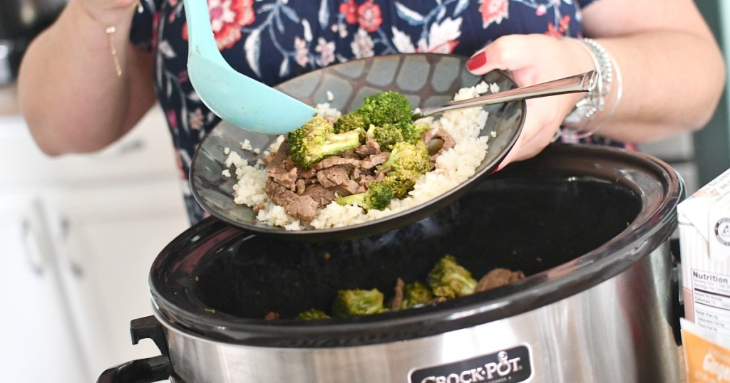 dishing up beef and broccoli from slow cooker