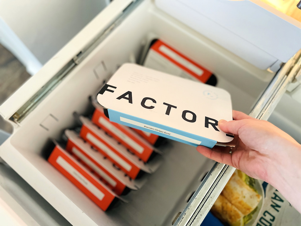 pulling Factor frozen meal out of freezer