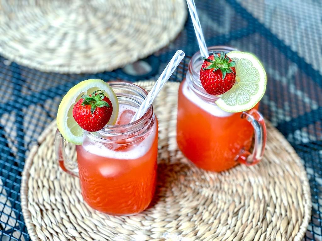 keto strawberry lemonade drinks with fresh strawberries and lemon wedge