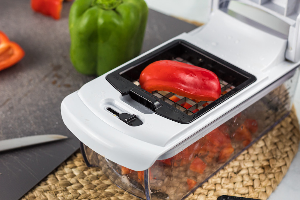 veggie chopper slicing red bell pepper