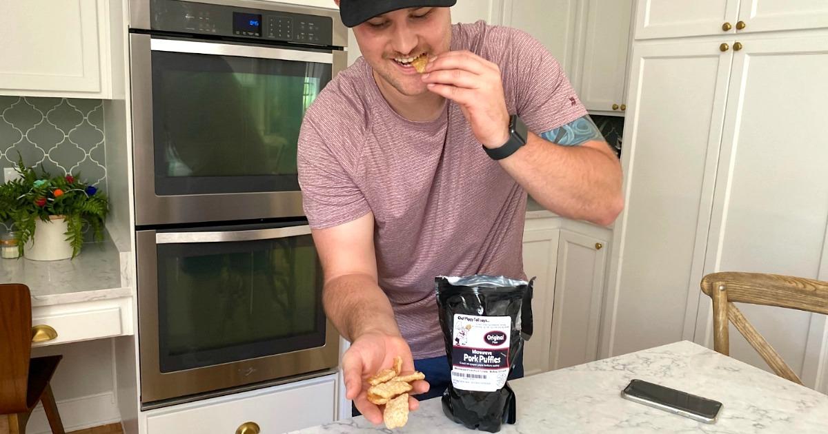 man eating microwaveable pork rinds