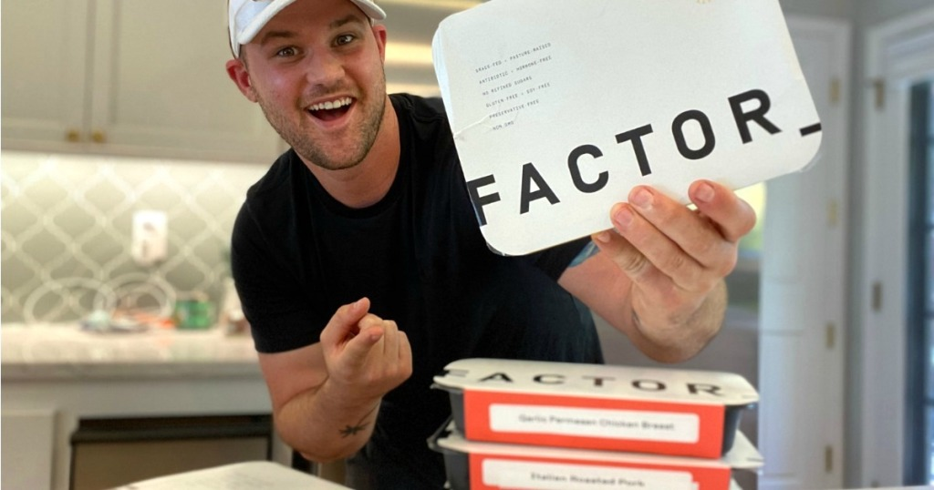 man holding Factor 75 meals